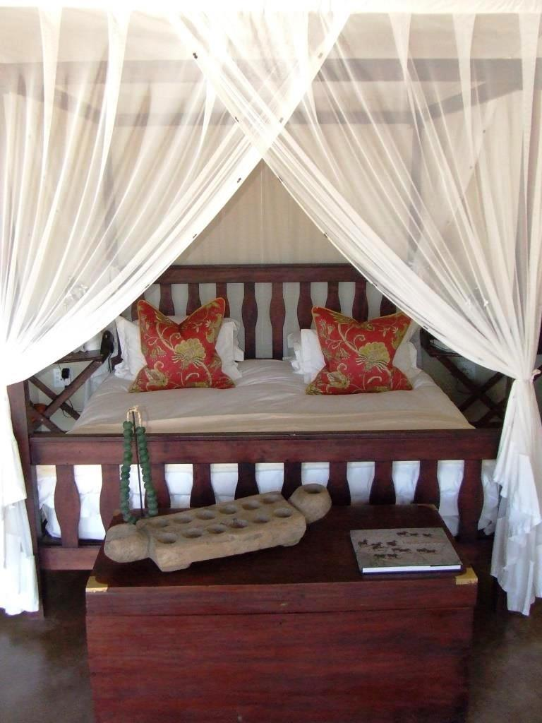 Front view of a king-sized bed at Kukama