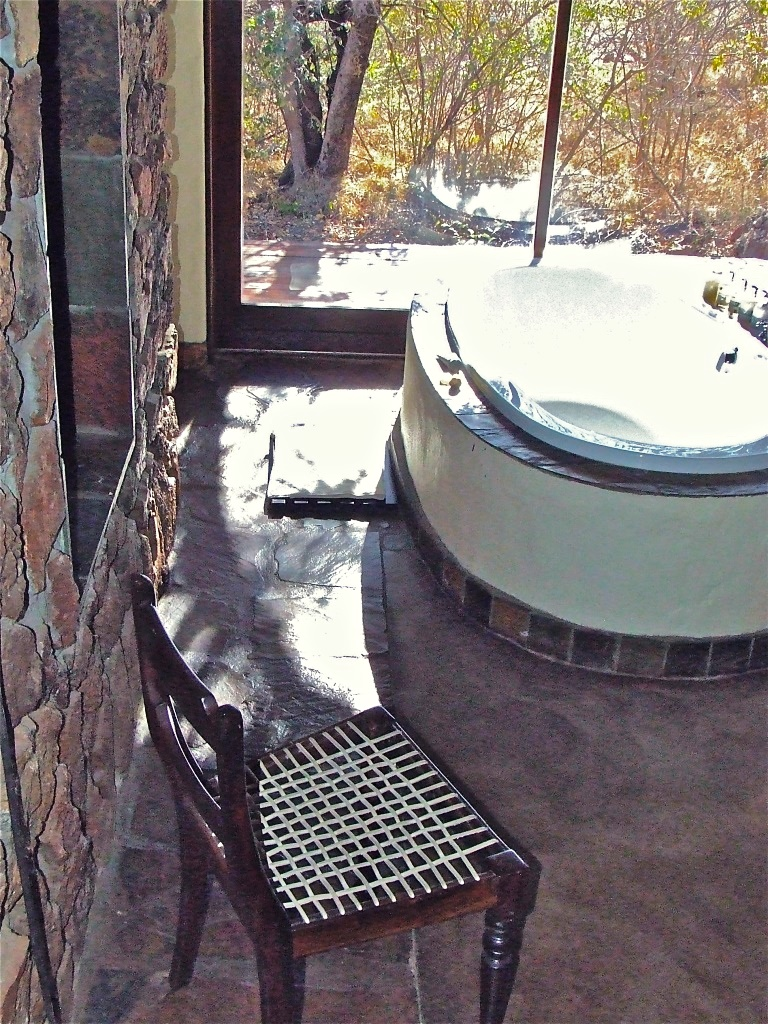 Indoor bathtub overlooking private suite deck